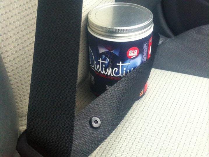 Seat belt safely fastening in a tub of Distinctive Washing powder